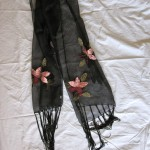 black scarf with sewn flowers